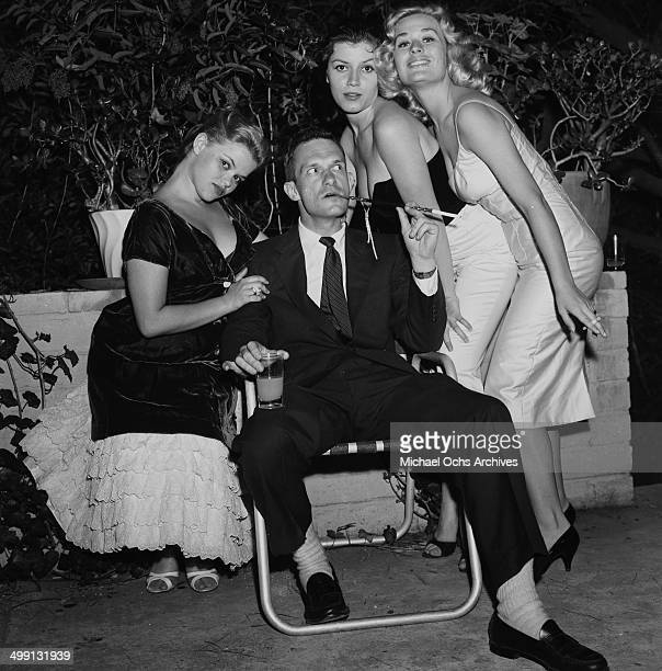 Hugh Hefner with Sylvia Sydney Joan Bradshaw and Caroline Mitchell at a Play Boy Party in Los Angeles California