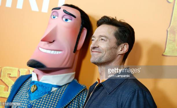 """Hugh Jackman and a cartoon character form the movie attend """"Missing Link"""" New York Premiere at Regal Cinema Battery Park on April 07, 2019 in New..."""