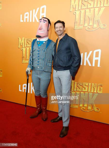 Hugh Jackman and a cartoon character form the movie attend Missing Link New York Premiere at Regal Cinema Battery Park on April 07 2019 in New York...