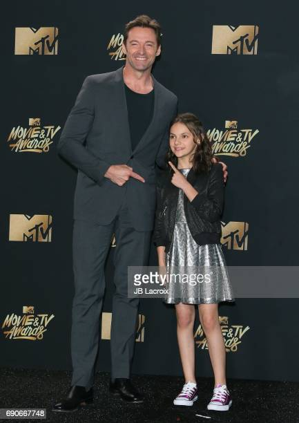 Hugh Jackman and Dafne Keen pose in the press room at the 2017 MTV Movie and TV Awards at The Shrine Auditorium on May 7 2017 in Los Angeles...
