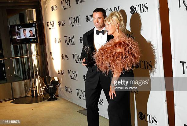 Hugh Jackman and DeborraLee Furness pose in the 66th Annual Tony Awards press room at The Beacon Theatre on June 10 2012 in New York City