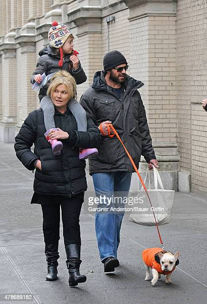 Hugh Jackman and DeborraLee Furness with their daughter Ava are seen walking their French bulldog puppy on January 25 2011 in New York City