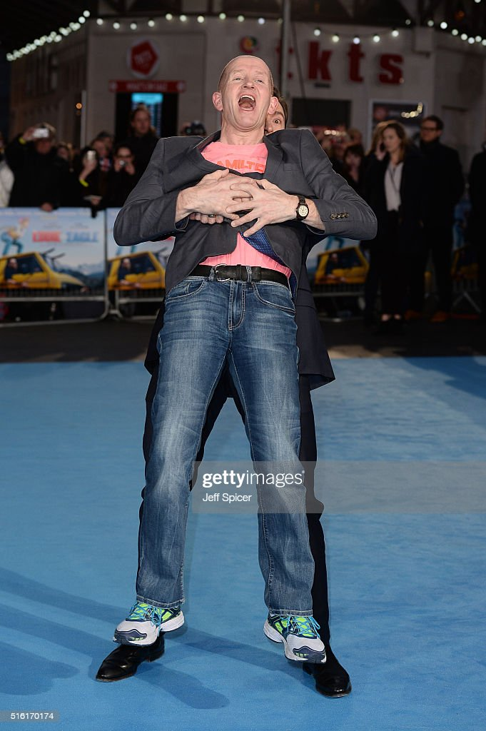 Hugh Jackman (Rear) and Eddie Edwards (Front) arrive for the European premiere of 'Eddie The Eagle' at Odeon Leicester Square on March 17, 2016 in London, England.