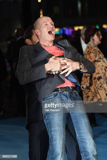 Hugh Jackman and Eddie Edwards arriving at the European premiere of Eddie the Eagle at the Odeon Leicester Square in London