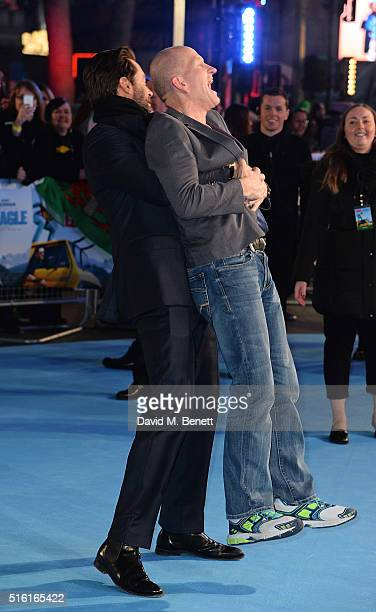 Hugh Jackman and Eddie Edwards attend the European Premiere of Eddie The Eagle at Odeon Leicester Square on March 17 2016 in London England