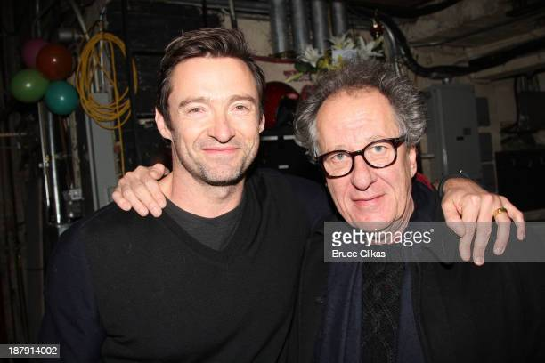 Hugh Jackman and Geoffrey Rush pose backstage at 'Big Fish' on Broadway at The Neil Simon Theater on November 13 2013 in New York City