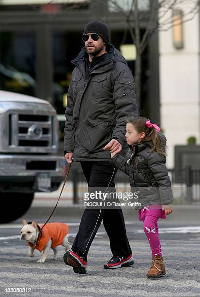 Hugh Jackman and his daughter Ava Eliot are seen walking their dog on March 14 2011 in New York City