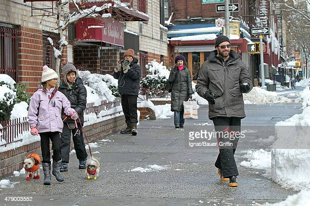 Hugh Jackman and his son Oscar Maximillian are seen as they walking their puppy Mocha on January 27 2011 in New York City