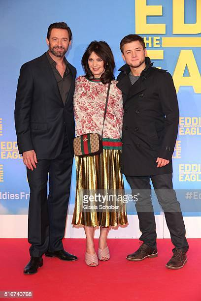 Hugh Jackman and Iris Berben and Taron Egerton during the 'Eddie the Eagle' premiere at Mathaeser Filmpalast on March 20 2016 in Munich Germany