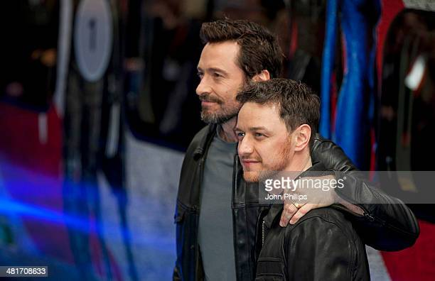 """Hugh Jackman and James McAvoy attend a photocall to unveil the Virgin Trains wrapped """"X-Men: Days of Future Past"""" train at Euston Station on March..."""