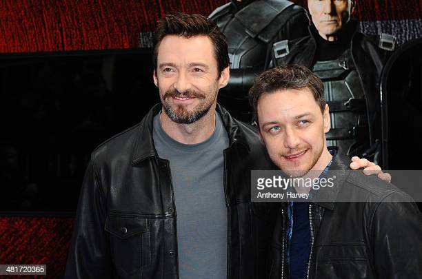 """Hugh Jackman and James McAvoy attends a photocall to unveil the Virgin Trains wrapped """"X-Men: Days of Future Past"""" train at Euston Station on March..."""