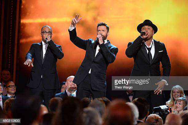 I Hugh Jackman and LL Cool J performs onstage during the 68th Annual Tony Awards at Radio City Music Hall on June 8 2014 in New York City