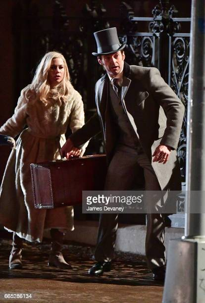 Hugh Jackman and Michelle Williams filming on location for 'The Greatest Showman' at Wiliamsburgh Savings Bank in Brooklyn on April 5 2017 in New...