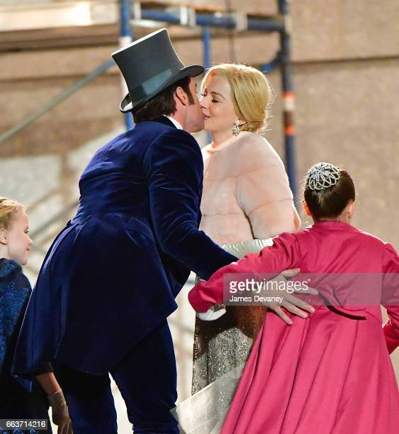 Hugh Jackman and Michelle Williams kiss while filming on location for 'The Greatest Showman' at 60 Centre Street on April 1 2017 in New York City
