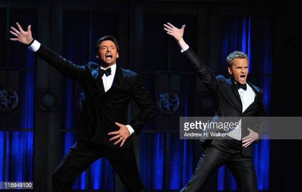 Hugh Jackman and Neil Patrick Harris perform on stage during the 65th Annual Tony Awards at the Beacon Theatre on June 12 2011 in New York City