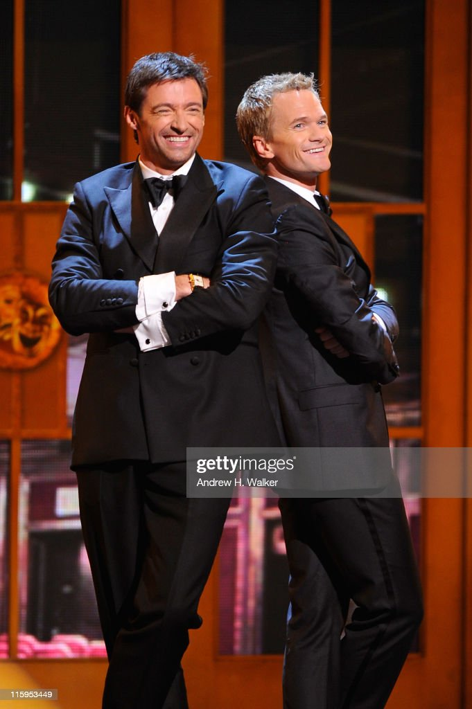 Hugh Jackman (L) and Neil Patrick Harris perform on stage during the 65th Annual Tony Awards at the Beacon Theatre on June 12, 2011 in New York City.