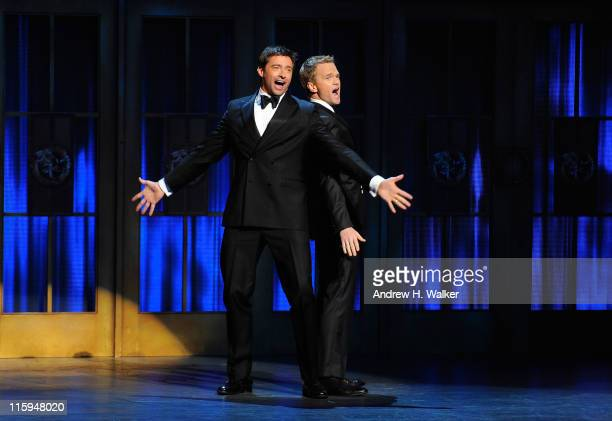 Hugh Jackman and Neil Patrick Harris speak on stage during the 65th Annual Tony Awards at the Beacon Theatre on June 12 2011 in New York City