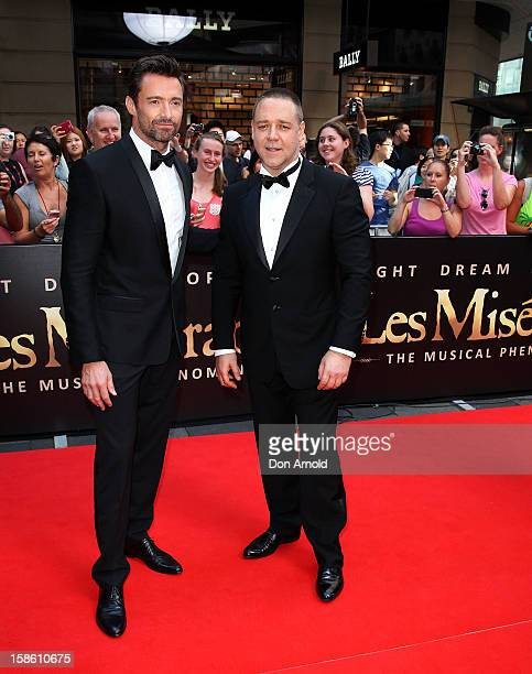 Hugh Jackman and Russell Crowe pose during the Australian premiere of 'Les Miserables' at the State Theatre on December 21 2012 in Sydney Australia