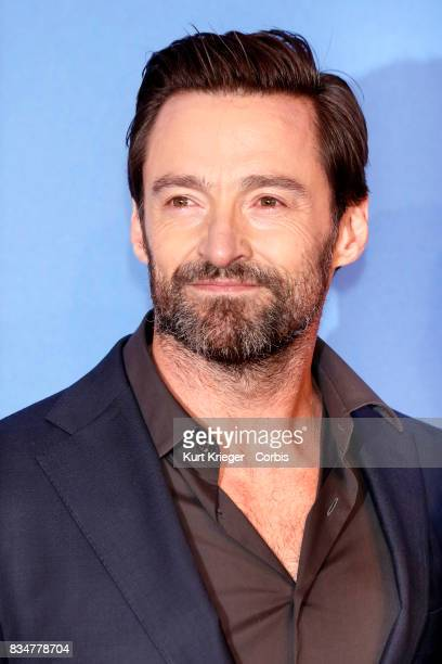 Image has been digitally retouched Hugh Jackman arrives at the 'Eddie the Eagle' premiere in Munich Germany on March 20 2016