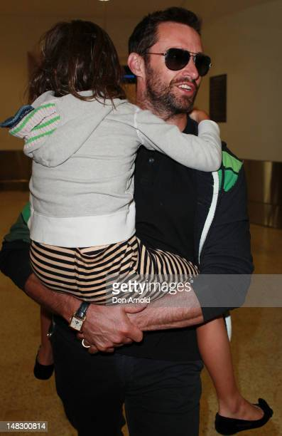 Hugh Jackman carries his daughter Ava as he arrives at Sydney International Airport on July 14 2012 in Sydney Australia