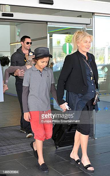 Hugh Jackman carrying his daughter Ava and wife DeborraLee Furness and their son Oscar are seen arriving at El Prat airport on June 18 2012 in...