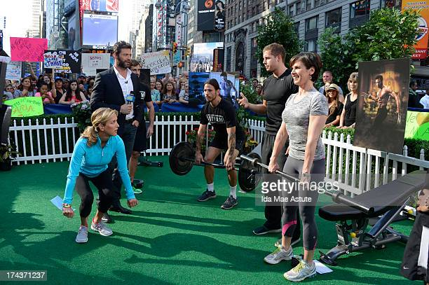 AMERICA Hugh Jackman coaches Lara Spencer and Elizabeth Vargas in the Wolverine workout on GOOD MORNING AMERICA 7/24/13 airing on the ABC Television...
