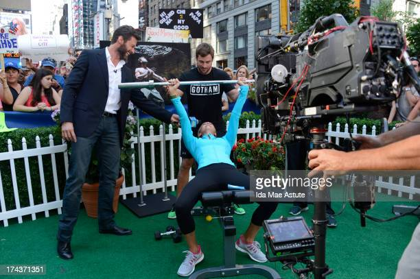 AMERICA Hugh Jackman coaches Lara Spencer in the Wolverine workout on GOOD MORNING AMERICA 7/24/13 airing on the ABC Television Network HUGH