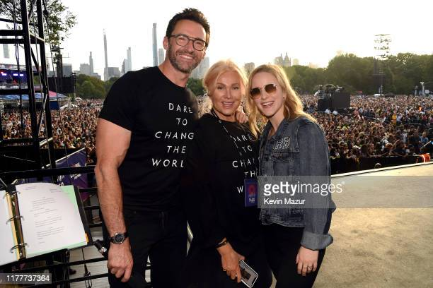 Hugh Jackman Deborralee Furness and Rachel Brosnahan pose onstage during the 2019 Global Citizen Festival Power The Movement in Central Park on...