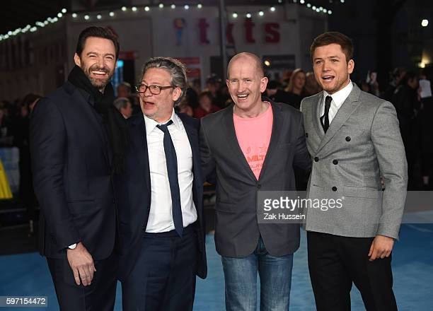 Hugh Jackman Dexter Fletcher Eddie Edwards and Taron Egerton arriving at the European premiere of Eddie the Eagle at the Odeon Leicester Square in...