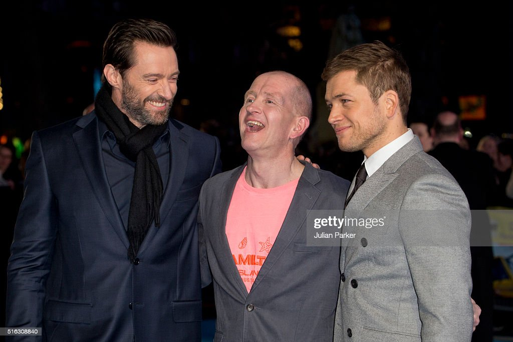 Hugh Jackman, Eddie 'The Eagle' Edwards,and Taron Egerton arrive for the European premiere of 'Eddie The Eagle' at Odeon Leicester Square on March 17, 2016 in London, England.