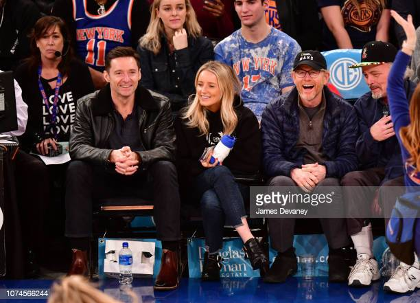 Hugh Jackman guest and Ron Howard attend Atlanta Hawks v New York Knicks game at Madison Square Garden on December 21 2018 in New York City