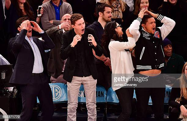 Hugh Jackman guest Jordyn Taylor and Trevor Noah attend Phoenix Suns Vs New York Knicks game at Madison Square Garden on January 21 2017 in New York...