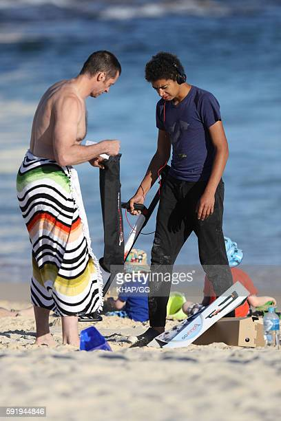 Hugh Jackman is seen at the beach with son Oscar Jackman and daughter Ava Jackman on August 16 2016 in Sydney Australia