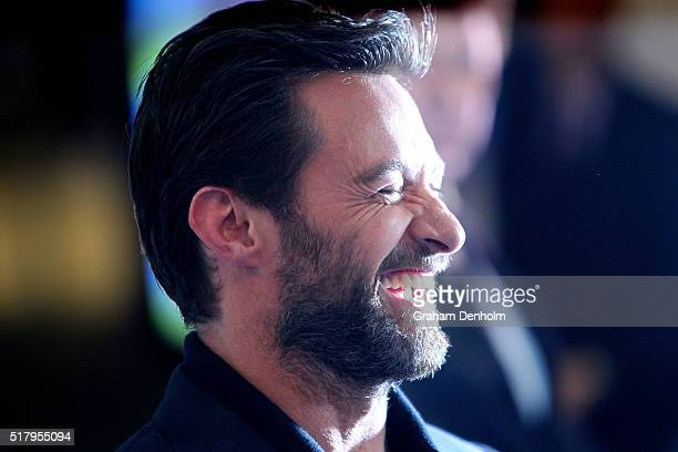 Hugh Jackman laughs as he arrives on the red carpet ahead of the Eddie The Eagle screening at Village Cinemas Crown on March 29 2016 in Melbourne...