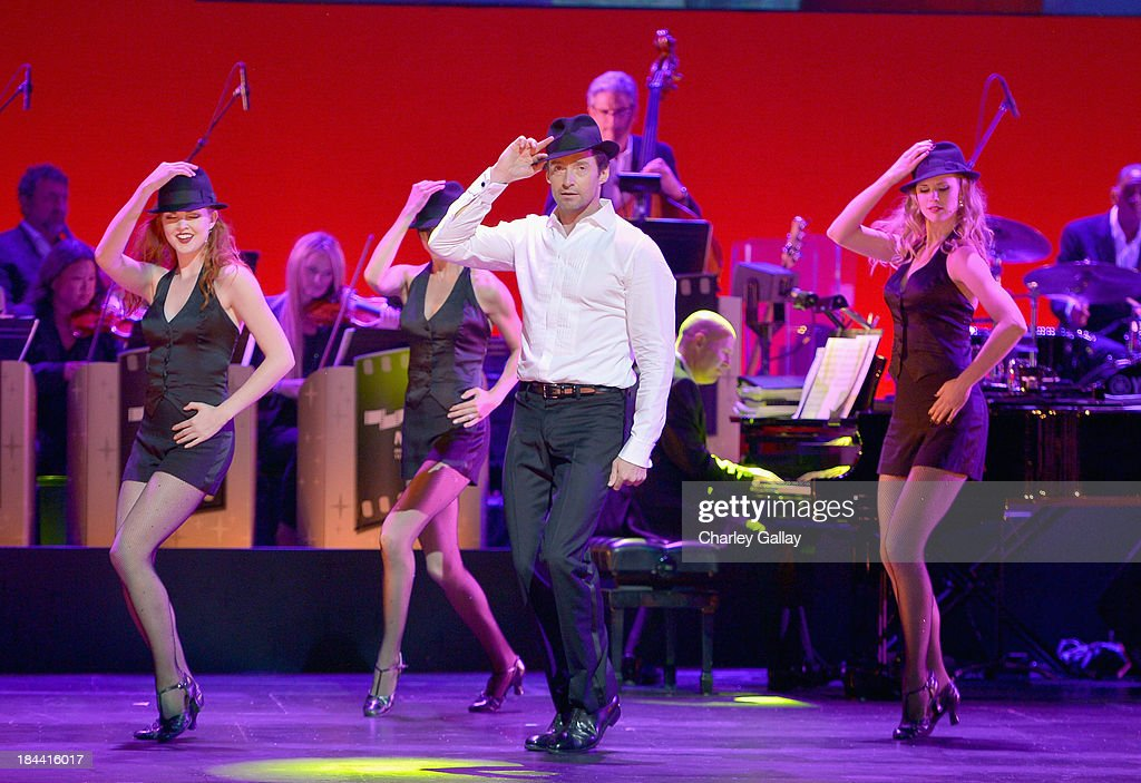 Hugh Jackman performs onstage during 'Hugh Jackman... One Night Only' Benefiting MPTF at Dolby Theatre on October 12, 2013 in Hollywood, California.
