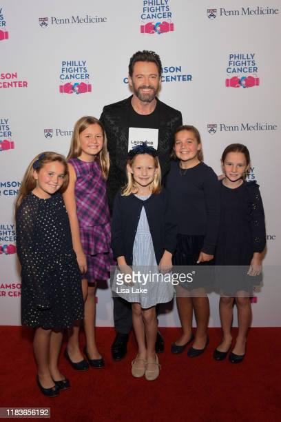 Hugh Jackman poses with Peyton Nolen Leonie Weissenberger Cece Gaffney Finley Nolen and Narin Nolen on the red carpet during the Philly Fights Cancer...