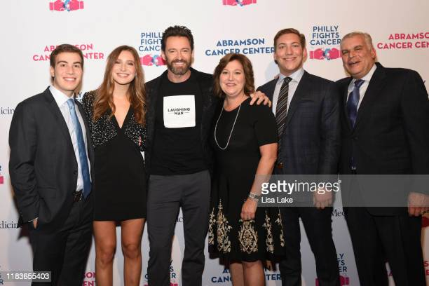 Hugh Jackman poses with the Felgoise family on the red carpet during the Philly Fights Cancer Round 5 Event benefiting Penn Medicine's Abramson...