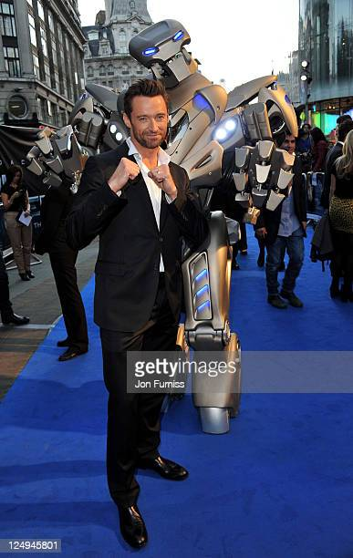 Hugh Jackman posses with Titan the Robot at the UK Premiere of 'Real Steel' at Empire Leicester Square on September 14 2011 in London England