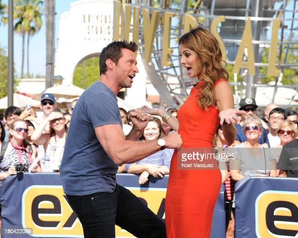 Hugh Jackman punches Maria Menounos in the stomach at Extra at Universal Studios Hollywood on September 12 2013 in Universal City California