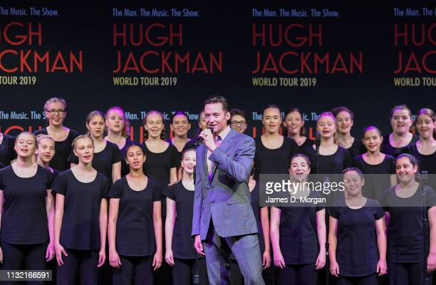 Hugh Jackman sings with the Australian Girls Choir during his media announcement at the Museum of Contemporary Art on February 26 2019 in Sydney...