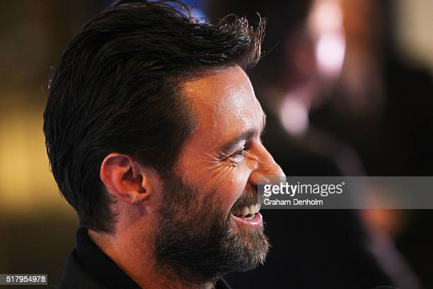 Hugh Jackman smiles he arrives on the red carpet ahead of the Eddie The Eagle screening at Village Cinemas Crown on March 29 2016 in Melbourne...