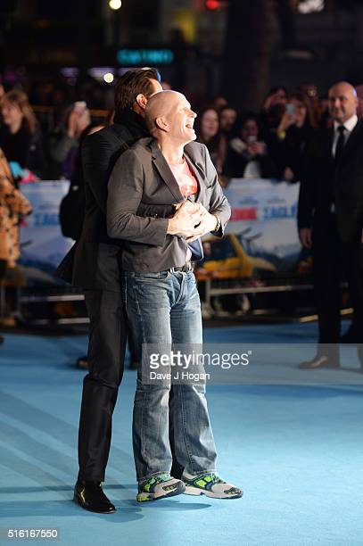 Hugh Jackman surprises Eddie The Eagle Edwards during the European premiere of 'Eddie The Eagle' at Odeon Leicester Square on March 17 2016 in London...