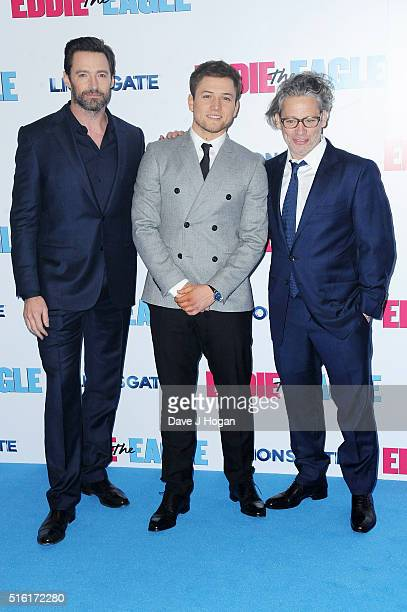 Hugh Jackman Taron Egerton and Director Dexter Fletcher attend the European premiere of 'Eddie The Eagle' at Odeon Leicester Square on March 17 2016...