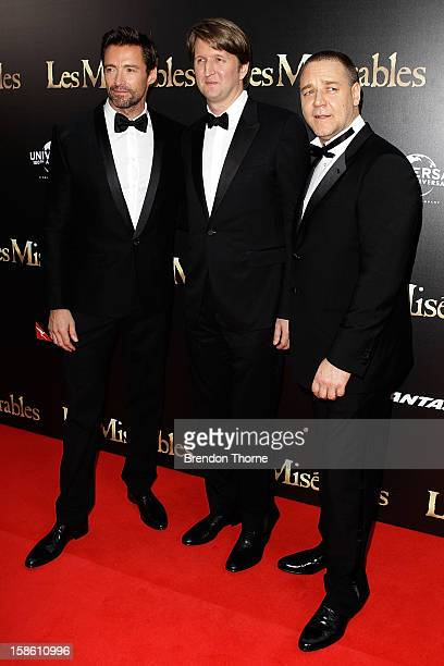 Hugh Jackman Tom Hooper and Russell Crowe walk the red carpet during the Australian premiere of 'Les Miserables' at the State Theatre on December 21...