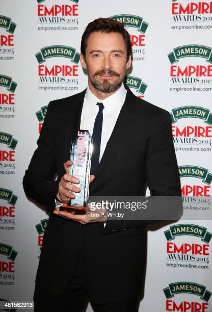 Hugh Jackman winner of the Empire Icon Award poses during the Jameson Empire Awards 2014 at the Grosvenor House Hotel on March 30 2014 in London...