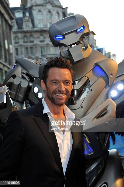Hugh Jackman with Titan the Robot arrives at the UK Premiere of 'Real Steel' at Empire Leicester Square on September 14 2011 in London England
