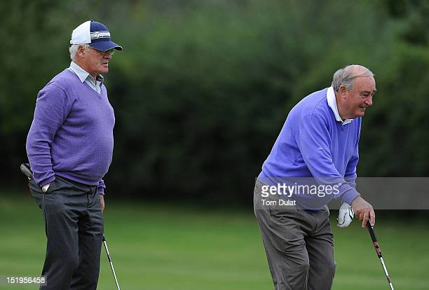Hugh Jackson and Jimmy Clynch line up a putt during the final day of the PGA Super 60's Tournament at the De Vere Belton Woods Golf Club on September...