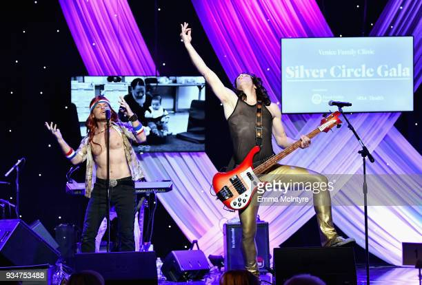 Hugh Jass and Moe Lato of The Wayward Sons perform on stage during the Venice Family Clinic Silver Circle Gala at The Beverly Hilton Hotel on March...