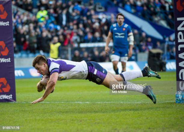 Hugh Jones dives over the line to score Scotland's second try during the NatWest Six Nations match between Scotland and France at Murrayfield on...