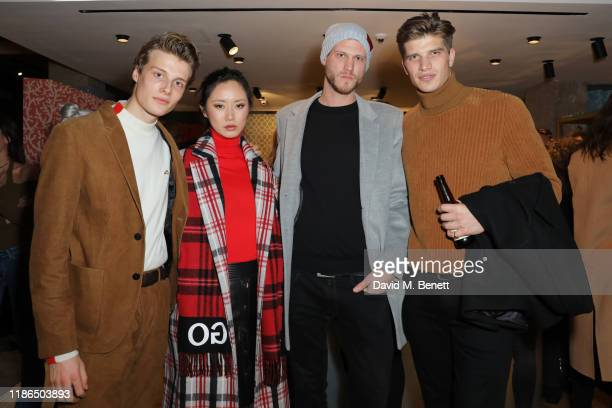 Hugh Laughton Scott Betty Bachz guest and Toby HuntingtonWhiteley attend the Hugo X Liam Payne Bodywear Campaign party at Flannels on December 4 2019...
